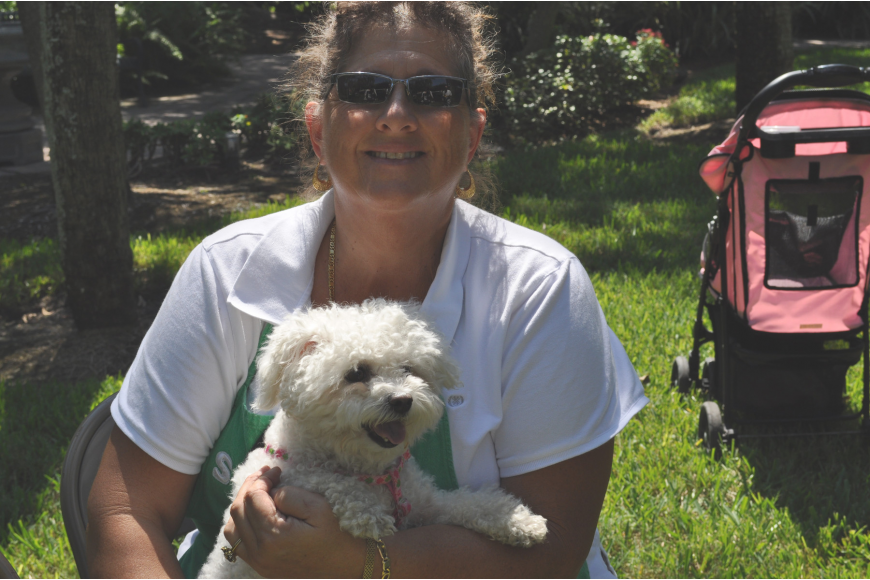 Christine Ortiz and her dog snowy. Ortiz wanted her dog blessed because,