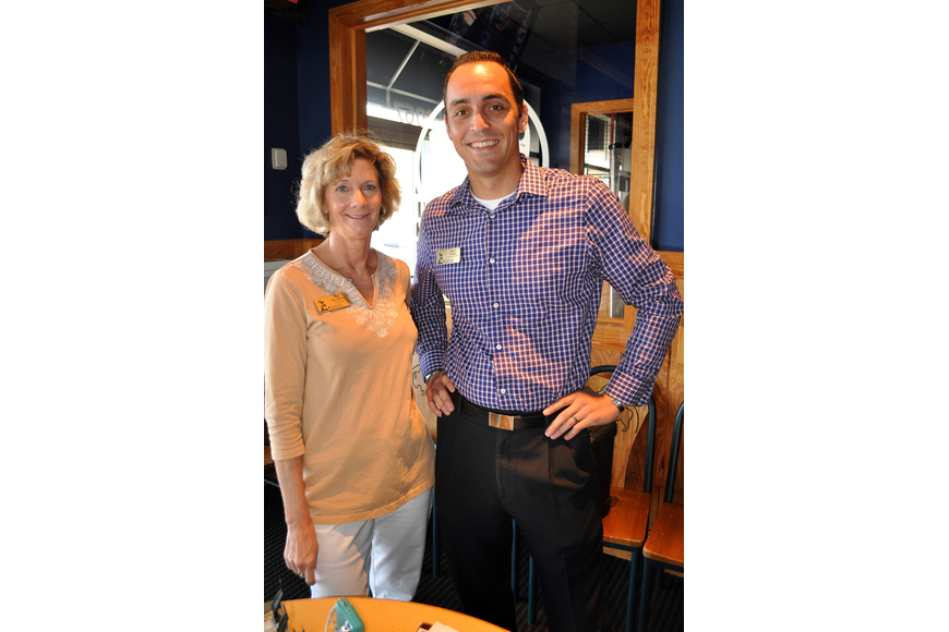 Tess Herschman and Kevin Cooper pose together during the Siesta Key Chamber luncheon Friday, Oct. 7 at Buffalo Wild Wings.