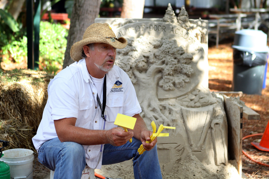 "Brian Wigelsworth shows off a set of yellow, starter kit tools called ""Can you dig it"" that were created to help kids create their own sand sculptures. The tools are sold at the Siesta Key hardware store."