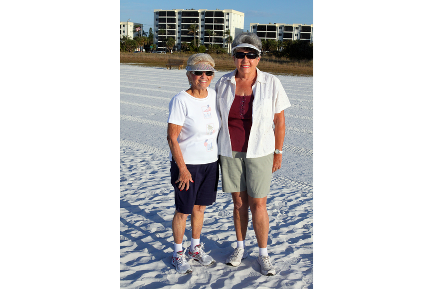 Mary Jane Smith and Pat Leroux wear their shiny visors to walk the beach, Wednesday, Feb. 1, during the Senior Beach Walk on Siesta Key Beach.