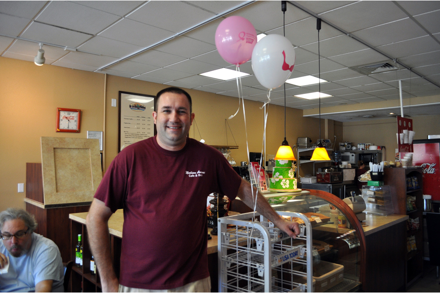 Brian Wilson of Madison Avenue Café and Deli poses with the balloons Saturday, Oct. 6, during Circle Me Pink.