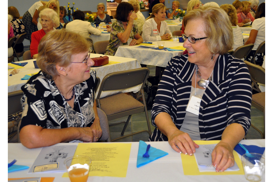 Donna Jean Leuchter and Arline Napiecek chit-chat Tuesday, Oct. 16, at the welcome back luncheon for the women's guild of St. Mary Star of the Sea.