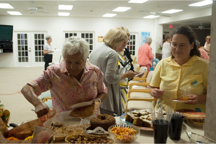 Garden Club members help themselves to refreshments.
