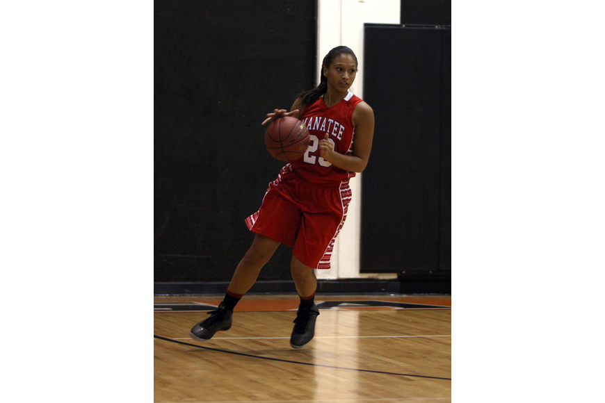 Manatee's Jasmine Luther, No. 23, dribbles the ball down the court.