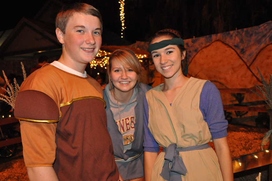 Quentin Murphy, Caitlin Hermanson and Shannon Furey dressed as townspeople.