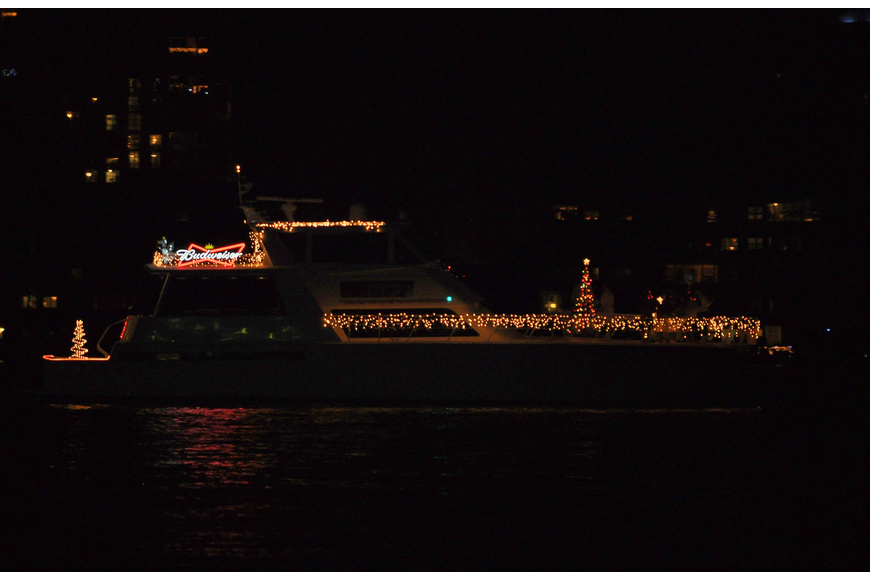 The Budweiser boat featured lit up Christmas trees.