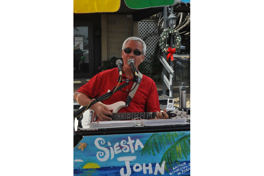John Sollazzo sings tunes at the Siesta Key Farmers Market.