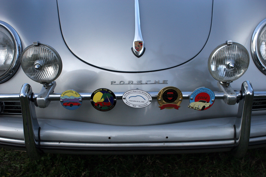 The front of Tom Holzer's 1959 356 A is decorated with a bunch of Porsche and car related medallions.