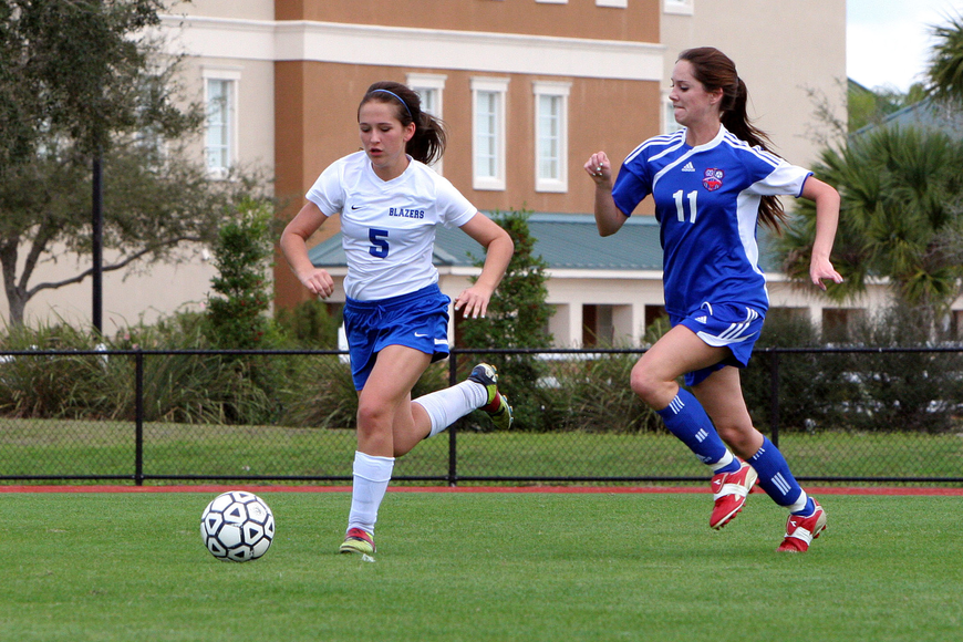 Sarasota Christian's Brittany Swart, No. 5, and Northside Christian's Kayla Church, No. 11, hustle to get to the ball.