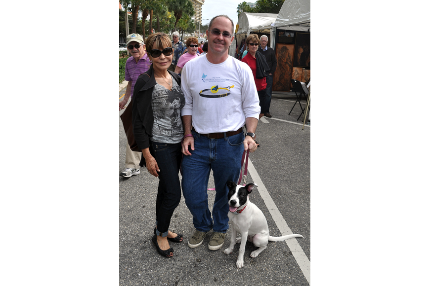 Chris and Kirk Voelker with their 6-month-old puppy, Lucy. Lucy was adopted from the Humane Society of Sarasota County.