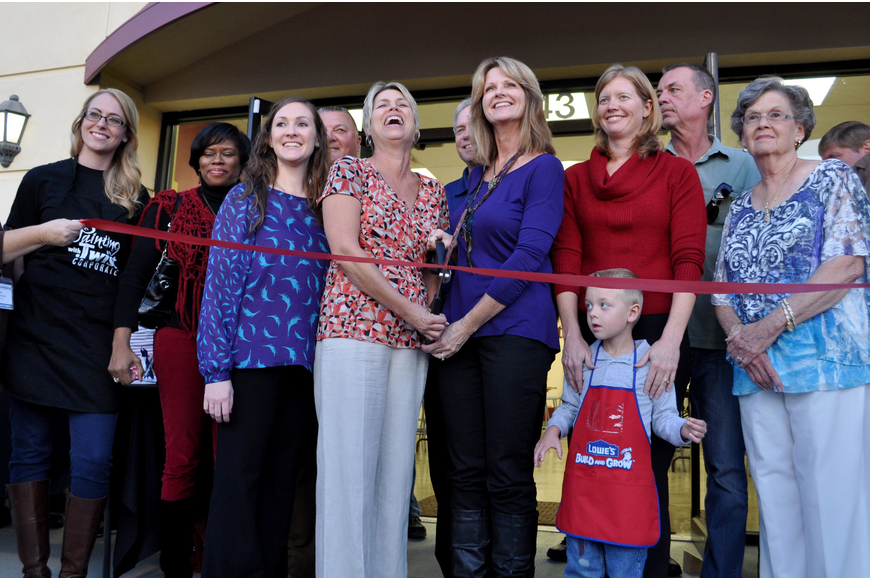 "Owners, Hope Kinney and Sheri Penxa, cut the ribbon at the grand opening of ""Painting with a Twist."""