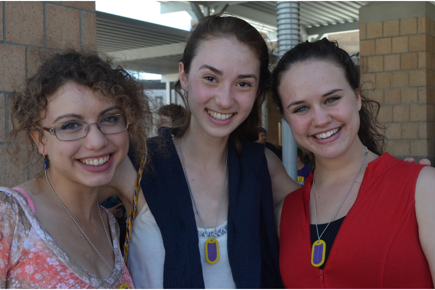 "Seniors Erica Janko, Olivia Goodfriend and Carolyn Silverman all wear gold dog tags symbolizing a 4.0 GPA or higher. ""Seeing all of my successful peers is the most exciting, "" said Goodfriend."