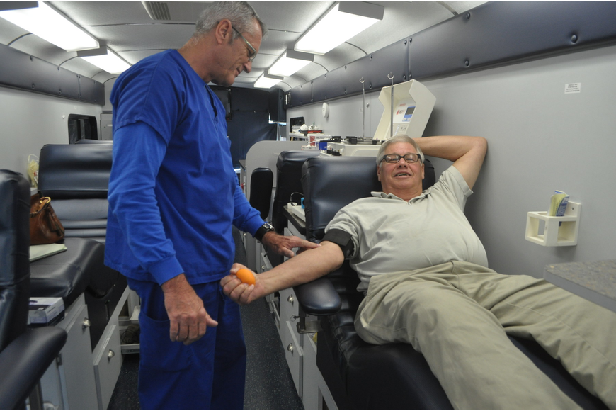 Fran Fougere preps John Holtzermann before a blood donation.