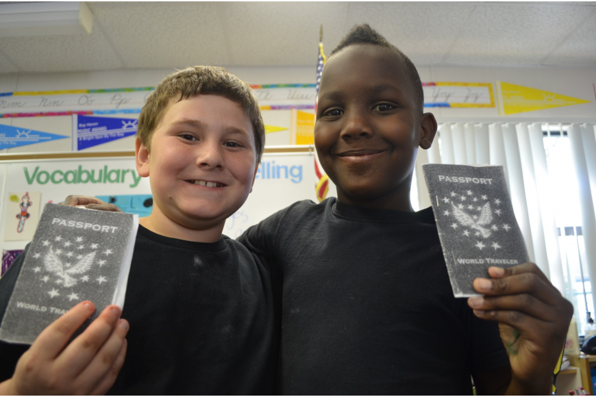 Hunter Coomer, 9, and Zepharin Williams, 9, show off their passports as they travel from classroom to classroom.