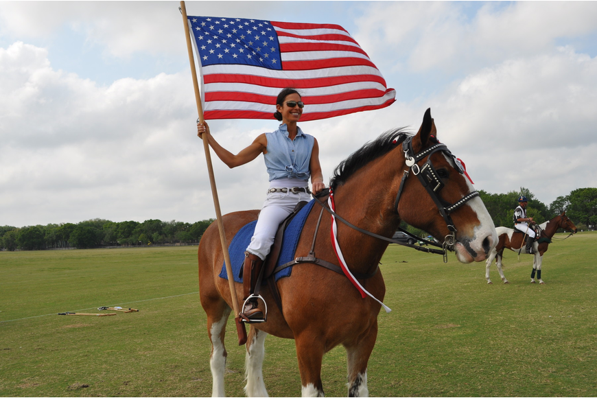 Erica Lane strode atop her horse with the American flag.