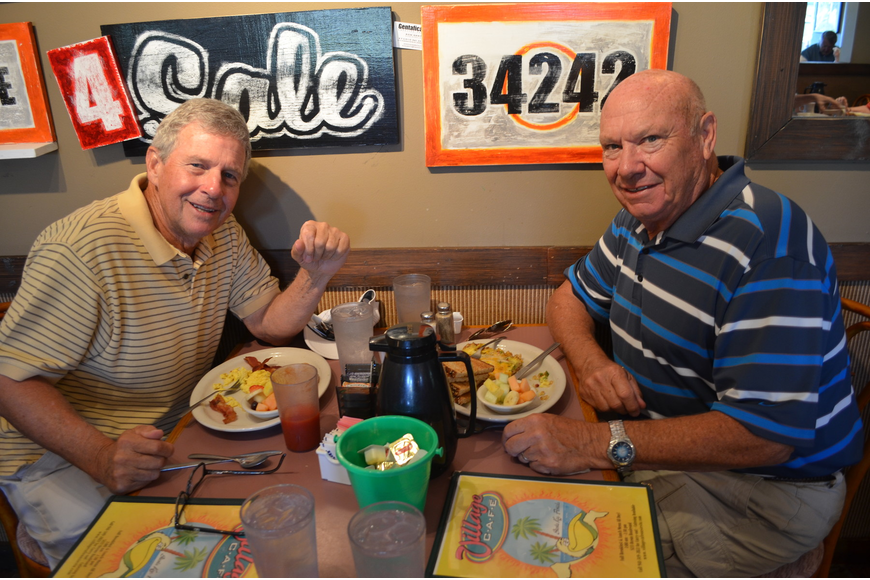 Bay Isle residents Paul Balliette and Malcolm Scott enjoy breakfast at Village Café before the Adopt-a-Road Pickup. Balliette moved to Siesta Key from Twinsburg, OH 20 years ago. Scott is originally from Toronto but has been in Florida for 37 years.