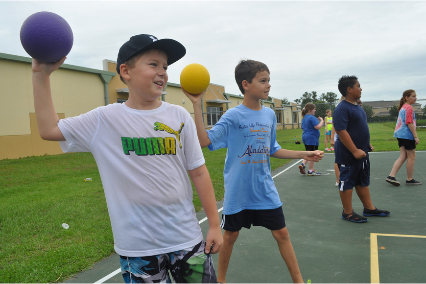 Forth-graders Evan Taylor and Caden Denslow sized up their targets in a game of dodgeball.