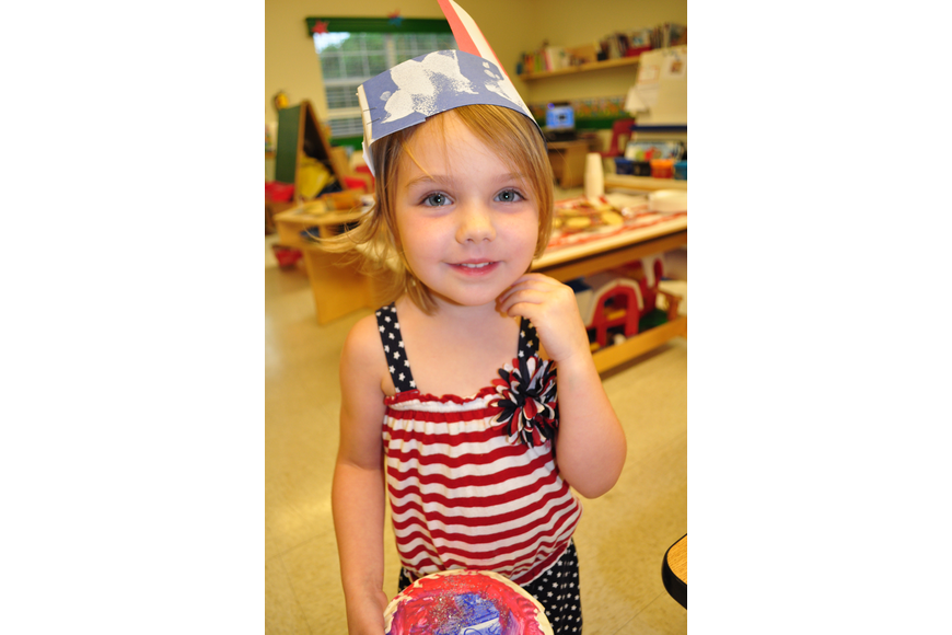 Luci Palmtag, 3, loves the day's patriotic theme.