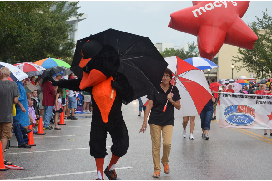 The Orioles Bird carries an umbrella to stay dry.
