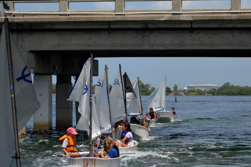 The 7-boat tail line gets pulled under the Coon Key Waterway bridge.