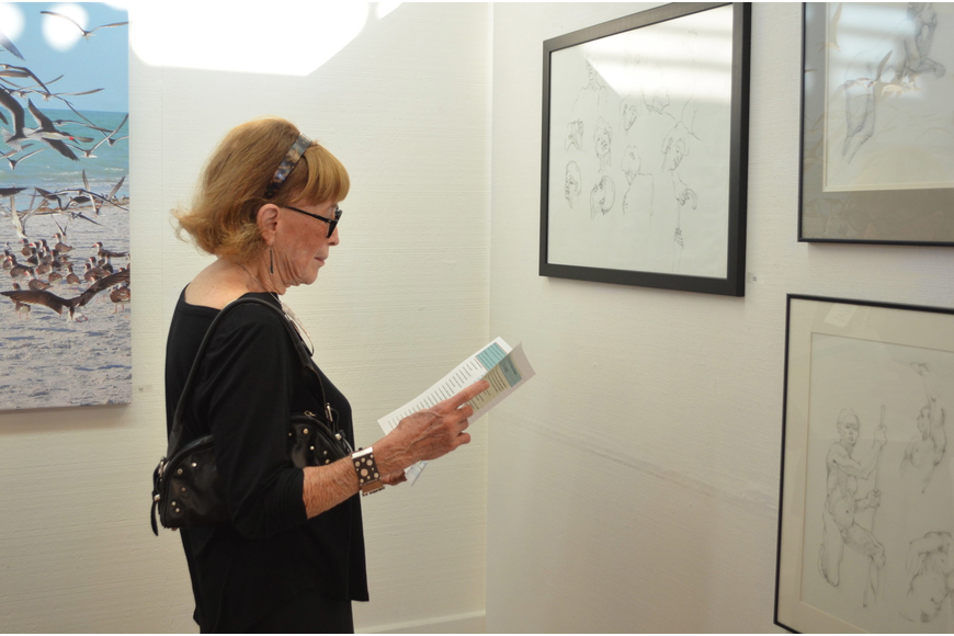 Gloria Weissberg admires some of the beautiful art displayed at the Longboat Key Center for the Arts.