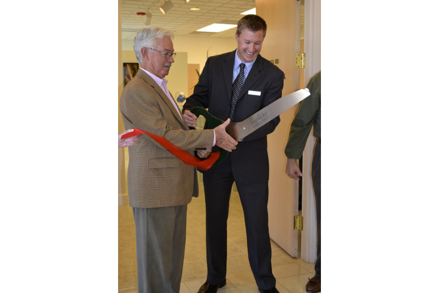 Mayor Jim Brown helps Dr. Michael O'Neil cut the tricky ribbon.