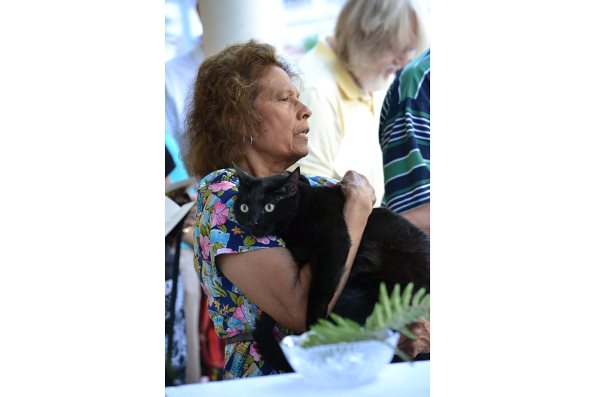 Batie Thomas holds her cat Lennox during during prayer at the Blessing of the Animals.