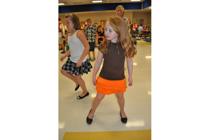 Hailey Wahlers, 8, quickly learned a line dance.