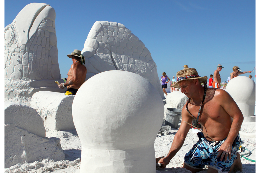 John Gowdy and Matt Deibert work on their sand sculpture during the Siesta Key Crystal Classic Master Sand Sculpting Competition.
