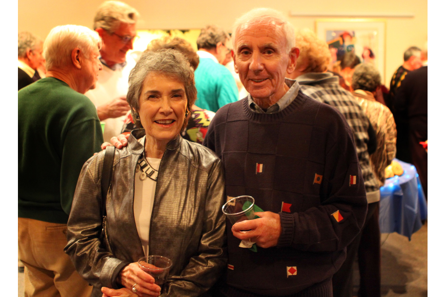 Kay and Allen Kershman pose together for a picture during Seaplace's Welcome Back Holiday Party.