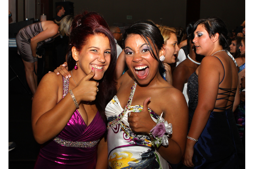 Laisy Almanza and Maria Arrate give two thumbs during Sarasota High School's prom.