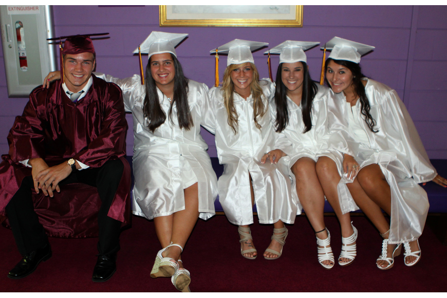 Cody Tope, Kiley Pritchard, Sam Byrd, Jill Bouziane and Katie Quintero sit on a bench while waiting to head up stairs to graduate Friday, May 27 at the Van Wezel Performing Arts Hall.