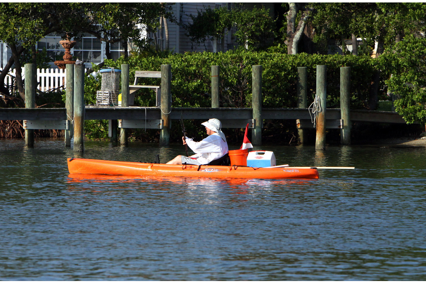 A kayaker makes their way out into the Bay to look for scallops Saturday, August 13 during the 4th Annual Sarasota Bay Great Scallop Search.