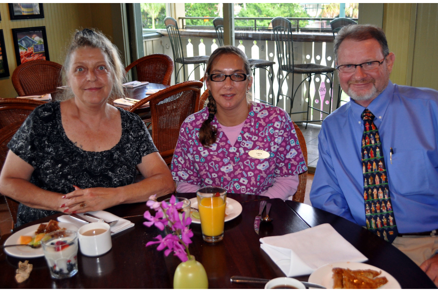 Sharon Sullivan, Laura Moyer and Mike Mackenzie sit together and enjoy their breakfast Tuesday, Aug., 16 at Tommy Bahama Restaurant.