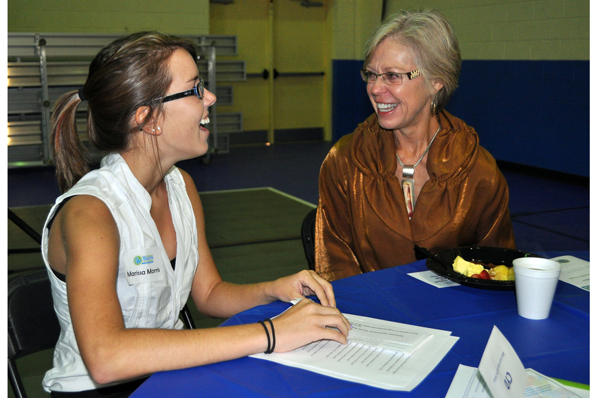 Marissa Morris, 16, from Pineview, chats with Roxie Jerde at the sixth annual Leadership Breakfast Thursday, Sept. 15, at the Lee Wetherington Boys & Girls Club.