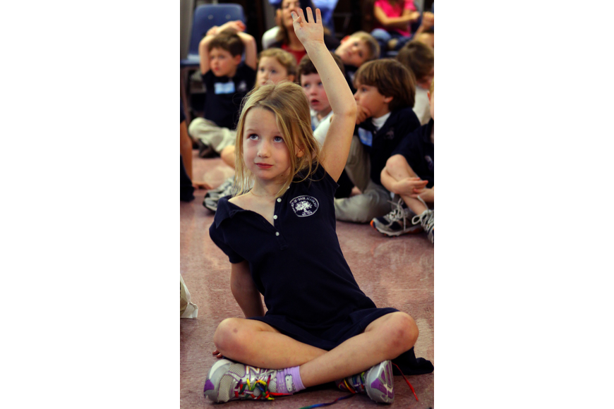 Caroline Steinwachs, 5, raises her hand to ask a question, Friday, Jan. 20, at Out-of-Door Academy.