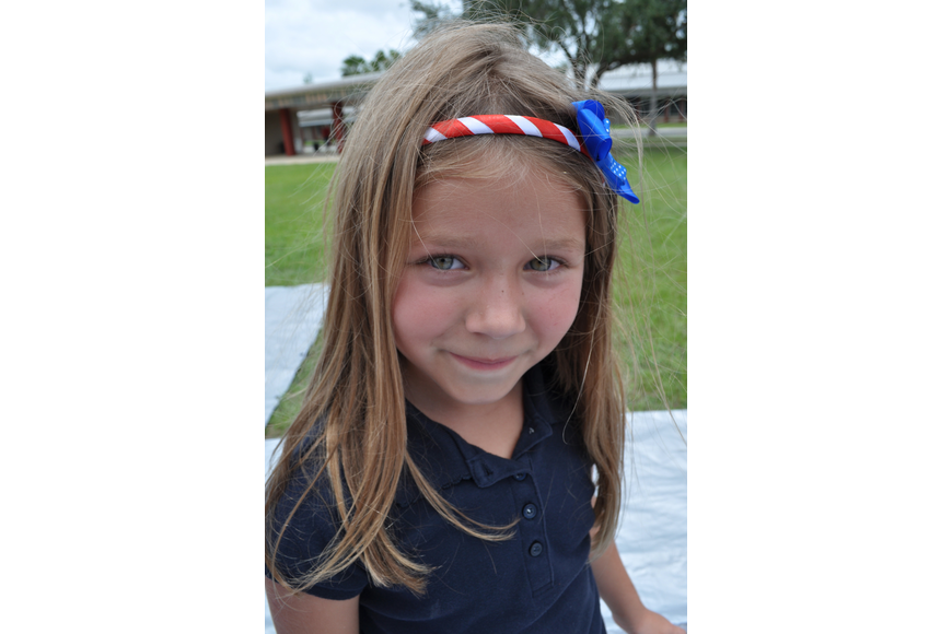 Danielle Vogel, 7, dressed patriotically for the day.
