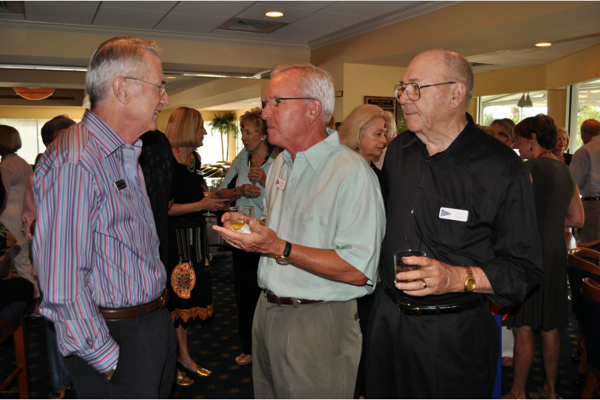 Commodore Bob Hunter, former commodore David Taylor and former commodore Jamo Powell talk to one another, Saturday, July 21, at Bird Key Yacht Club.