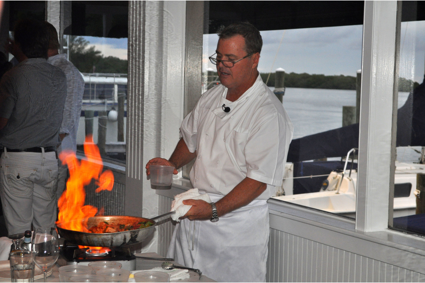 Tommy Klauber shows off his flambéing skills while leading the interactive dinner, Friday, Aug. 17, at Pattigeorge's.