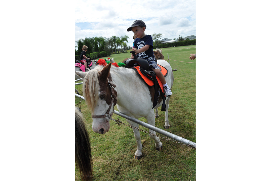 Andrew Fertig, 3, was all smiles during his first on a pony.