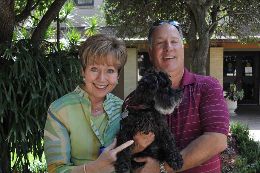 Peg and Leo Latini hold their dog, Holly.