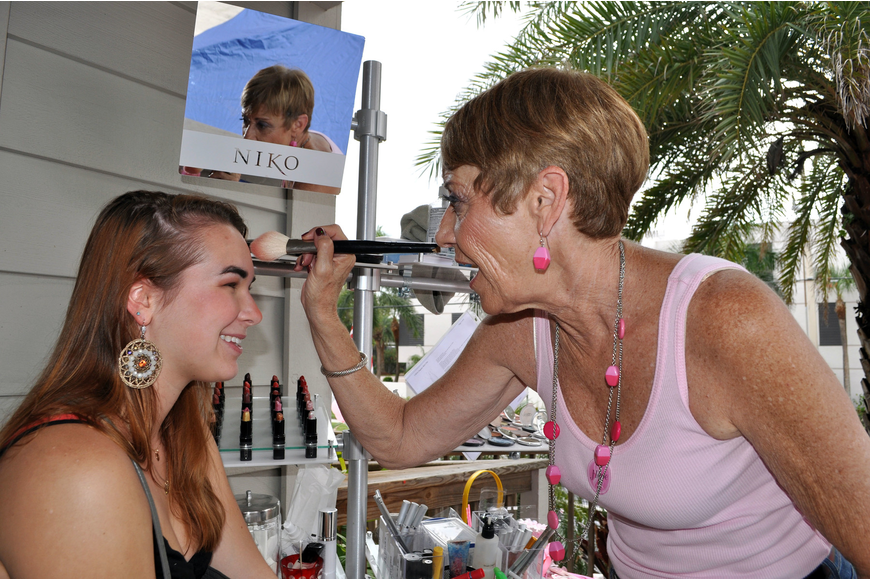 Abby Ruehlmann has her makeup done by Joan Woods of Sassy Hair Salon Sunday, Oct. 14.