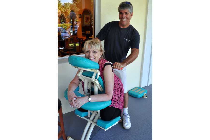 Susan Goldfarb gets a massage from Kurt Phillips of Message Therapy Services Sunday, Oct. 28, during the Fall Festival at the Centre Shops.