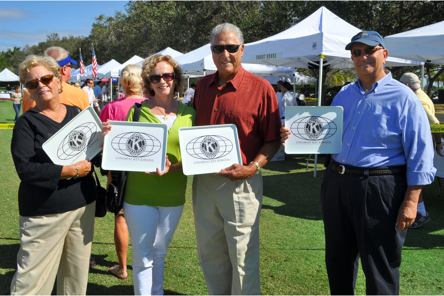 Linda Jackson, Rosie and Steve Petty and Steve Jackson show off their Longboat Key Kiwanis Club trays Saturday, Nov. 17, at the Longboat Key Gourmet Lawn Party.