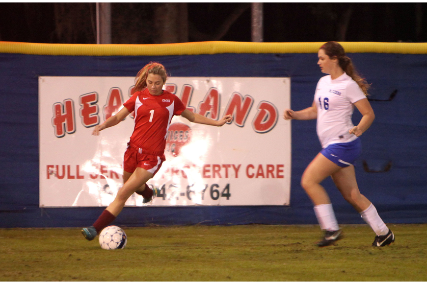 Cardinal Mooney's Anna Brusco, No. 1, tries to keep the ball away from Sarasota Christian's Sydney Kinsch, No. 16.