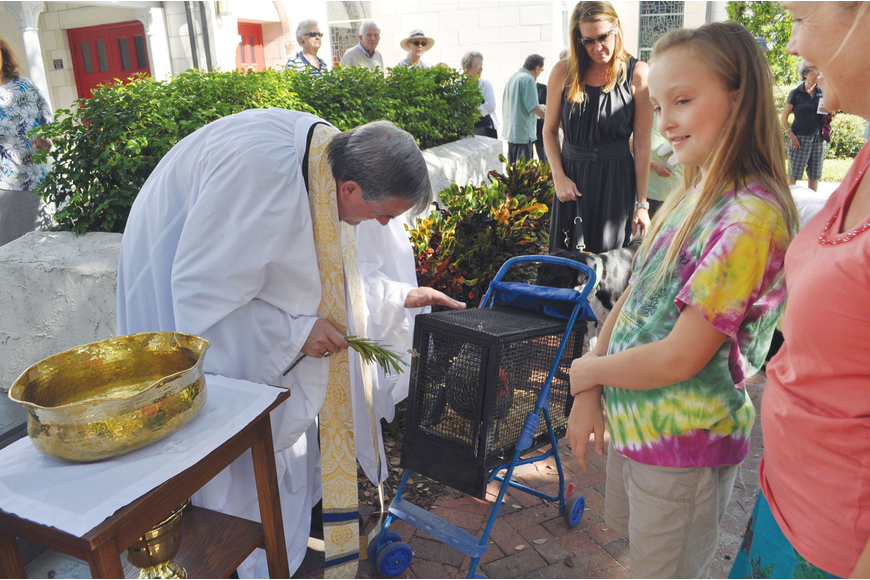 Ellie Fitzgerald brought her hen, Roxy, to be blessed at Church of the Redeemer's Blessing of the Animals.