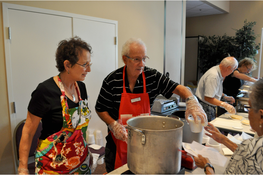 Rona and Hy Polakoff serve up cabbage soup.