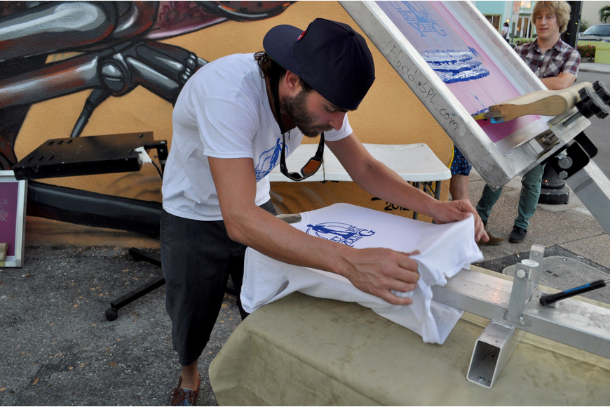 Joe Lombardi screen-prints a shirt for the event.