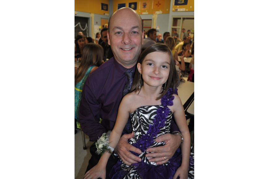 Robert MacDonald twirled his daughter, Rio, 10, on the dance floor.
