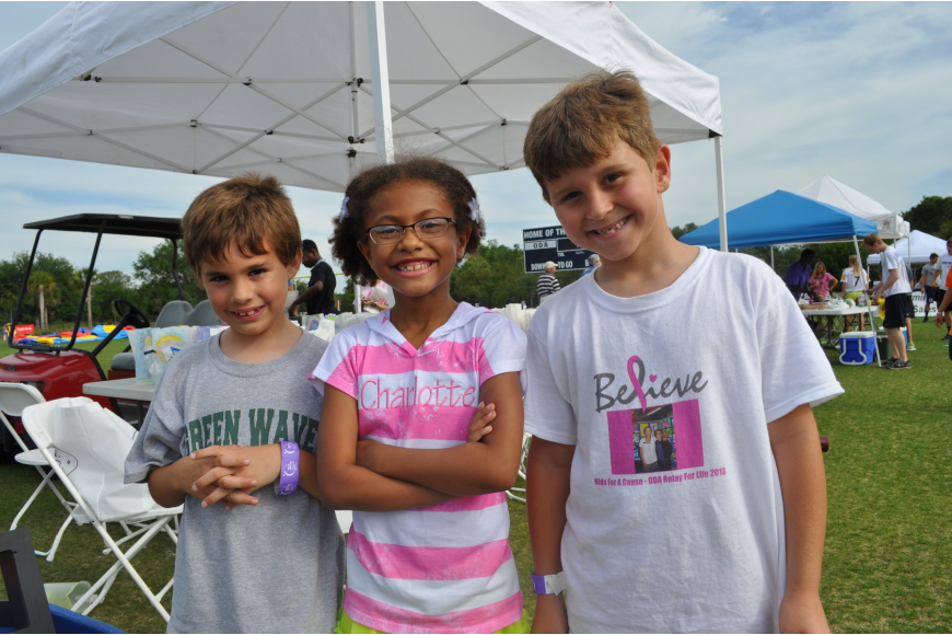 Drew Hill, Charlotte Blake and Giovanni Giuliani helped set up a booth and painted faces.